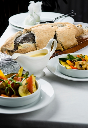 Baked whole fish in a salt crust served with vegetable salad and